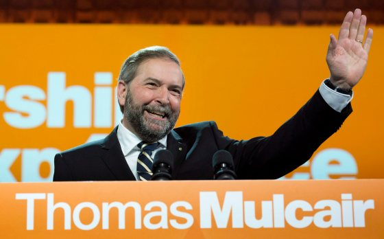 NDP Leader Thomas Mulcair waves after addressing delegates following a confidence vote during the party's weekend convention Saturday, April 13, 2013 in Montreal. THE CANADIAN PRESS/Paul Chiasson
